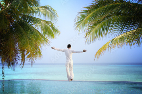 Man standing at Luxury tropical Infinity Pool (Maldives)