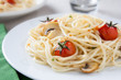 Spaghetti sautéed with cherry tomatoes and mushrooms