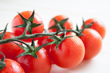 cherry tomatoes on branch