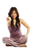 Young asian woman cross legged pointing