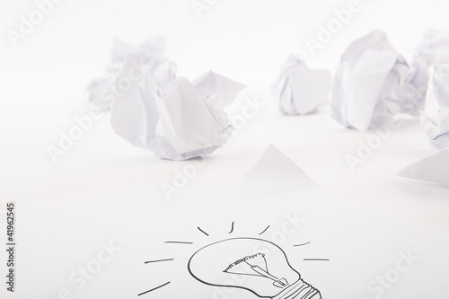 Light bulb write on white paper with Crumpled paper