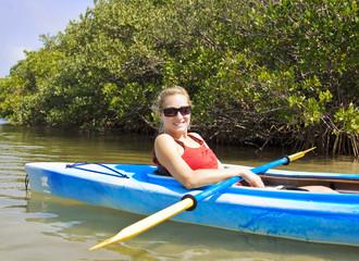 Beautiful woman enjoying a kayak ride