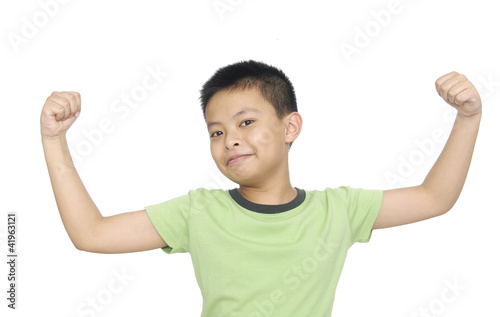 portrait of an innocent little boy flexing biceps