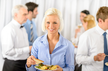 Smiling business woman during company lunch buffet