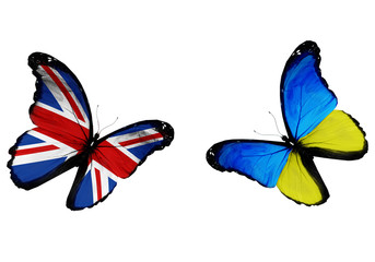 Concept - two butterflies with Ukrainian and English flags flyin