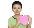 Child holding golden gift heart box in hand
