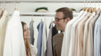 Customer and sales manager in fashion store while shopping