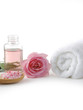 Rose flowers and massage lotion, Spoon of spa salt