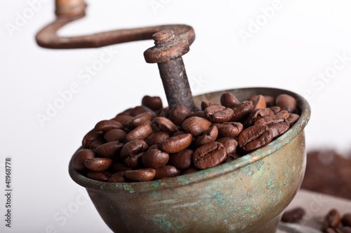wooden Coffee grinder with coffe beans