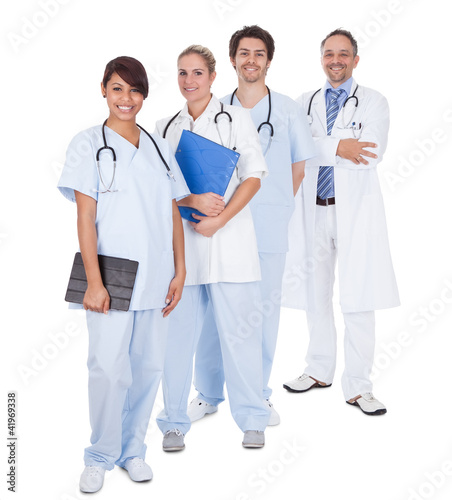 Group of doctors standing together over white