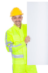 Worker in safety jacket presenting empty board