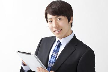 タブレット端末を持つビジネスマン