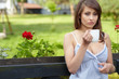 Portrait of cute teenage girl with cup of coffee on the terrace
