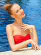 Glamorous woman posing in the pool
