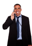 Attractive broker laughing on phone poster