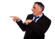 Friendly hispanic businessman pointing