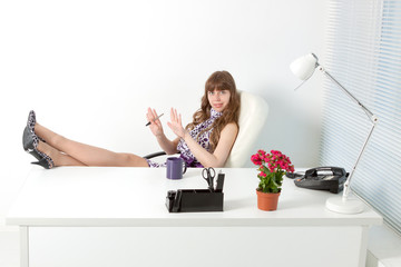 young  secretary with nail file in a comfortable modern office