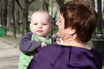 Grandmother holding toddler
