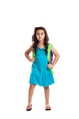 Litte schoolgirl standing with backpack isolated on white