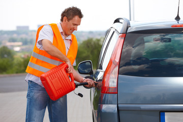 Man pouring fuel