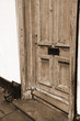 Wooden door with a mail slot in sepia