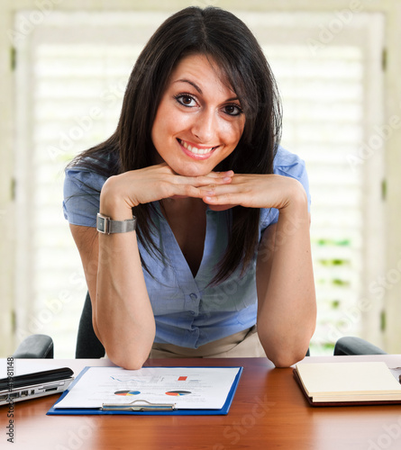 Young businesswoman at her desk