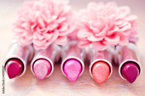 glamour lipsticks and flower petals