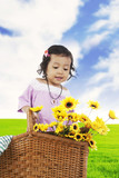 Sweet little girl with sunflowers