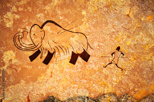 Leinwanddruck Bild Cave painting of primitive hunt
