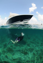 fit young woman snorkeling underwater