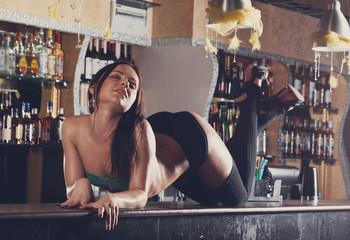 young women dancing on bar