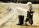kid  in harvested field. Photo in old image style. - 41991946