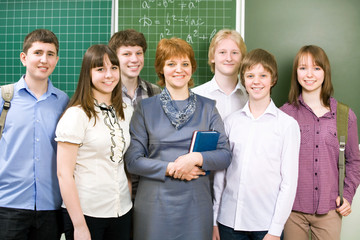Schoolboys and schoolgirls with teacher