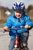 Fototapety Kind lernt Radfahren