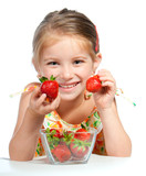 Fototapety little cute girl holding a strawberry
