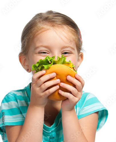 little girl eating a sandwich isolated