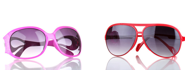 Two women's sunglasses pink and red isolated on white