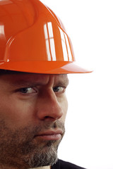 Sceptical construction worker on white