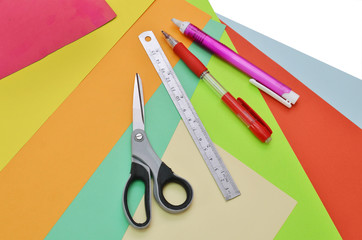 closeup of papers, ruler, scissors, pencil and eraser