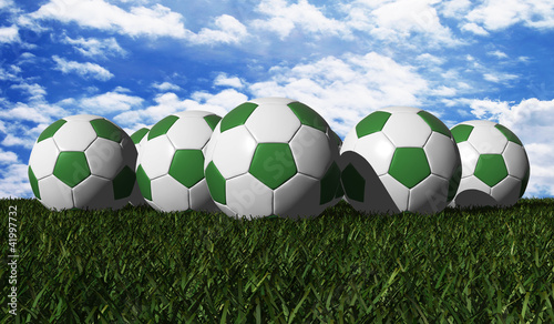 Green soccer ball on a green grass