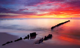 Fototapety Baltic sea at beautiful sunrise in Poland beach.
