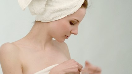 Beautiful young woman wrapped in towel; Full HD Photo JPEG