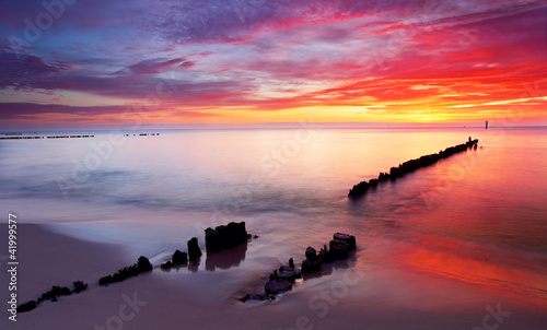 Baltic sea at beautiful sunrise in Poland beach.