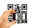 hand with mobile phone scanning QR code