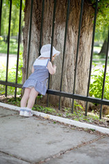 Little girl near fence