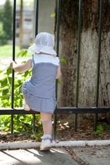 Little girl near fence