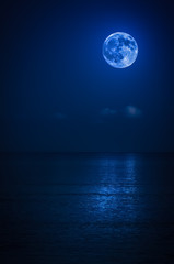 Bright full moon with reflections on the ocean