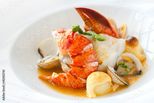 Seafood dish with lobster. - 42003761