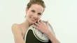 Young woman holding a bathroom scale ; Full HD Photo JPEG