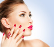 Woman with bright red lips and manicure
